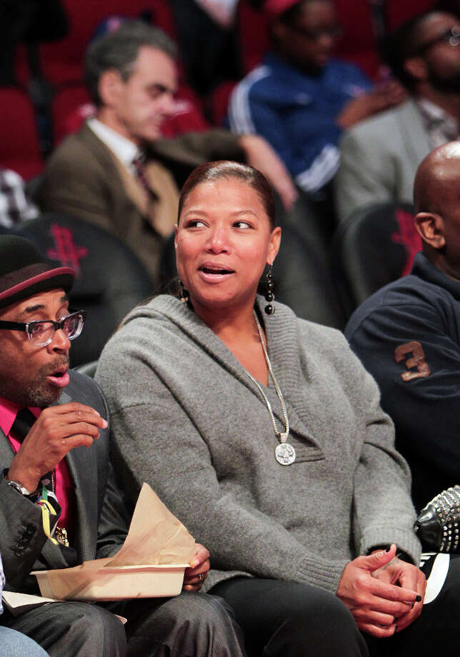 Queen Latifah watches the NBA All-Star Shooting Stars competition with Spike Lee. Photo: James Nielsen, Houston Chronicle / © 2013  Houston Chronicle