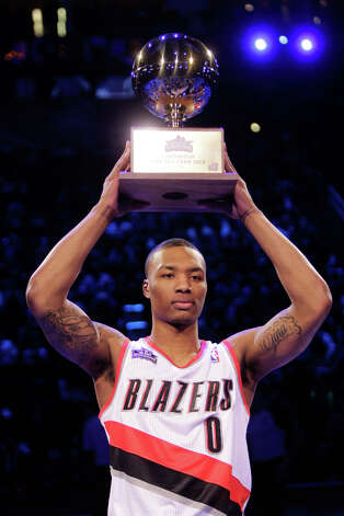 Damian Lillard of the Portland Trailblazers shows off the trophy after winning the NBA All-Star Skills Challenge. Photo: Melissa Phillip, Houston Chronicle / © 2013  Houston Chronicle