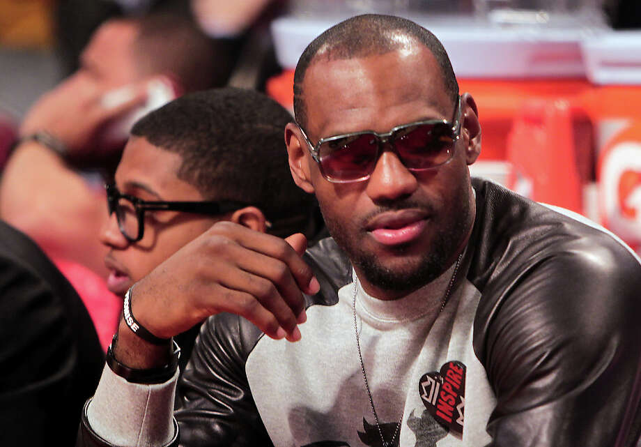 LeBron James of the Miami Heat sits courtside at the Toyota Center on All-Star Saturday Night. Photo: James Nielsen, Houston Chronicle / © 2013  Houston Chronicle