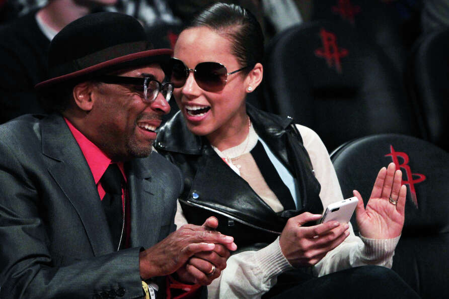 Alicia Keys sits with Spike Lee in the front row.