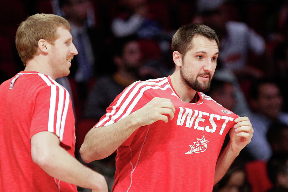 Ryan Anderson of the New Orleans Hornets shows of his Western Conference colors as he and Matt Bonner of the San Antonio Spurs prepare to compete in the NBA All-Star Three-Point Contest. Photo: Melissa Phillip, Houston Chronicle / © 2013  Houston Chronicle