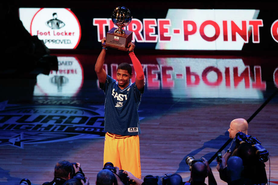 Kyrie Irving of the Cleveland Cavaliers holds up the trophy after winning the NBA All-Star Three-Point Contest. Photo: Billy Smith II, Houston Chronicle / © 2013 Houston Chronicle