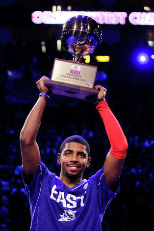 Kyrie Irving of the Cleveland Cavaliers hoists the trophy after winning the NBA All-Star Three-Point Contest. Photo: Melissa Phillip, Houston Chronicle / © 2013  Houston Chronicle