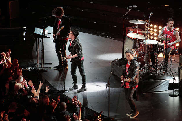 Fall Out Boy performs during NBA Saturday Night. Photo: Billy Smith II, Houston Chronicle / © 2013 Houston Chronicle