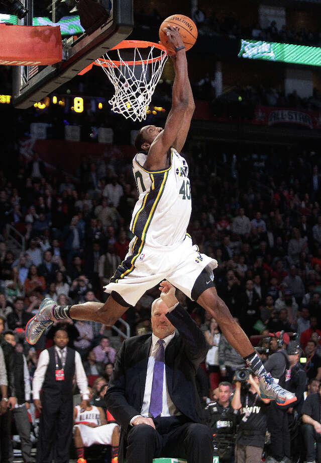 Jeremy Evans of the Utah Jazz dunks over former Jazz player Mark Eaton during the NBA All-Star Slam Dunk Contest. Photo: Melissa Phillip, Houston Chronicle / © 2013  Houston Chronicle