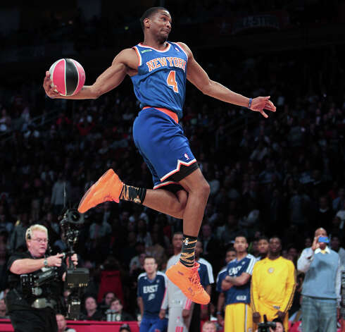 James White of the New York Knicks  competes in the NBA All-Star Slam Dunk Contest. Photo: James Nielsen, Houston Chronicle / © 2013  Houston Chronicle