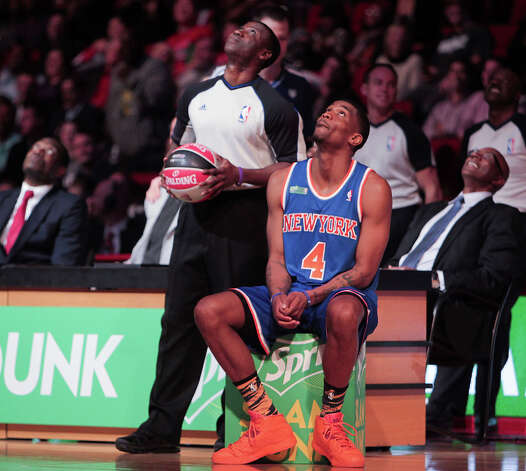 James White of the New York Knicks  looks up a the video replay during the NBA All-Star Slam Dunk Contest. Photo: James Nielsen, Houston Chronicle / © 2013  Houston Chronicle