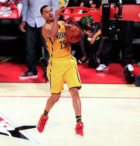 Gerald Green of the Indiana Pacers  tries to complete a double dunk move as he competes in the NBA All-Star Slam Dunk Contest. Photo: Billy Smith II, Houston Chronicle / © 2013 Houston Chronicle