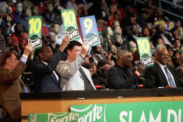 Rudy Tomjanovich, Dikembe Mutombo, Yao Ming, Hakeem Olajuwon, and  Clyde Drexler judge the NBA All-Star Slam Dunk Contest. The five Houston Rockets legends scored dunks in the first round of the event. Photo: Melissa Phillip, Houston Chronicle / © 2013  Houston Chronicle