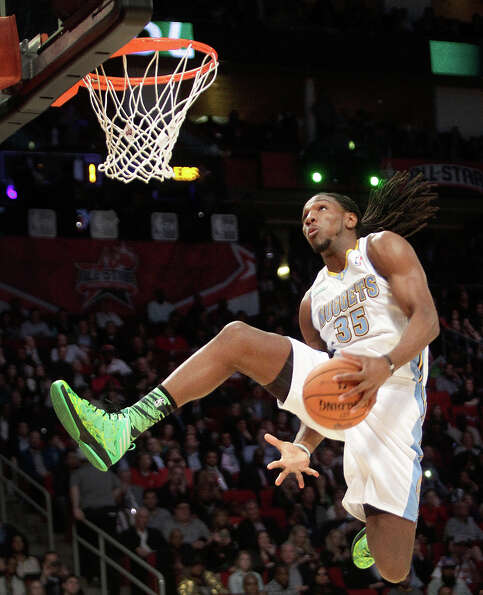 Kenneth Faried of the Denver Nuggets  competes in the NBA All-Star Slam Dunk Contest.