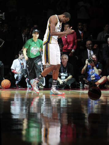 Jeremy Evans of the Utah Jazz  reacts after making a dunk in the NBA All-Star Slam Dunk Contest. Photo: James Nielsen, Houston Chronicle / © 2013  Houston Chronicle
