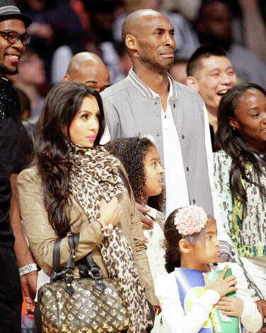Kobe Bryant of the Los Angeles Lakers watches the NBA All-Star Slam Dunk Contest with his family. Photo: Melissa Phillip, Houston Chronicle / © 2013  Houston Chronicle