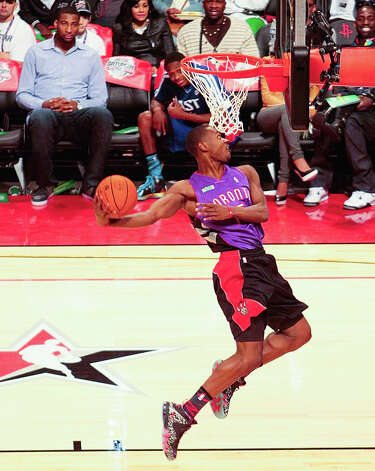 Terrence Ross of the Toronto Raptors  wears a Vincer Carter jersey as he competes in the NBA All-Star Slam Dunk Contest. Photo: Billy Smith II, Houston Chronicle / © 2013 Houston Chronicle