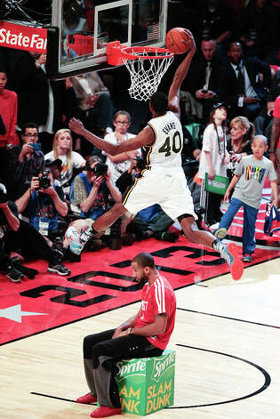 Jeremy Evans of the Utah Jazz  competes in the NBA All-Star Slam Dunk Contest. Photo: Billy Smith II, Houston Chronicle / © 2013 Houston Chronicle