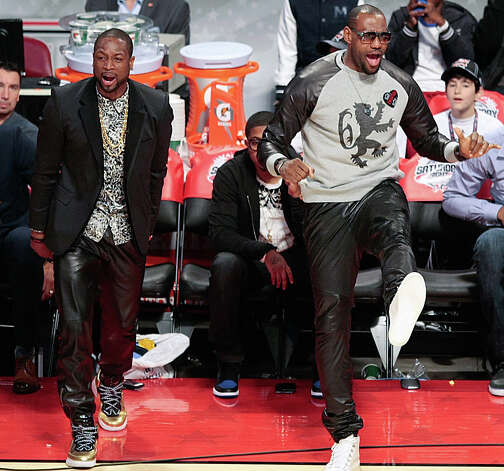 Miami Heat All-Stars Dwayne Wade and LeBron James cheer on Kyrie Irving of the Cleveland Cavaliers as he competes in NBA All-Star Three-Point Contest. Photo: Billy Smith II, Houston Chronicle / © 2013 Houston Chronicle