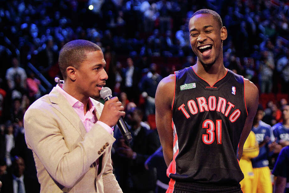Terrence Ross of the Toronto Raptors laughs with Nick Cannon after winning the NBA All-Star Slam Dunk Contest. Photo: Melissa Phillip, Houston Chronicle / © 2013  Houston Chronicle