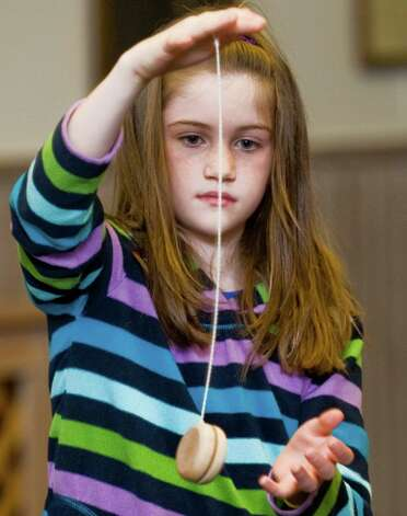 Roxanne Edel, 9, of New Milford, works on the basic yo-yo technique at the New Milford Library's Yo-Yo Day event. Saturday, Feb. 16, 2013 Photo: Scott Mullin / The News-Times Freelance