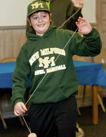 Steven Horwath, 11, of New Milford, having fun at the New Milford Library's Yo-Yo Day event. Saturday, Feb. 16, 2013 Photo: Scott Mullin / The News-Times Freelance