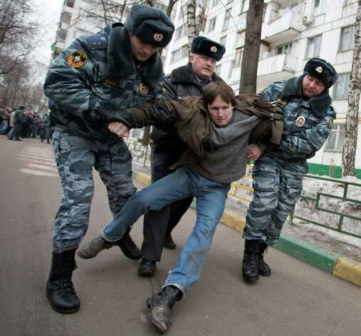 Police officers detain a supporter of Russian opposition leader Sergei Udaltsov, who came to congratulate him on his birthday in Moscow, Russia, Saturday. Udaltsov, a top Russian opposition figure, has been placed under house arrest for two months, a move that also bans him from using most forms of communication, including the internet, telephone and mail. Last week, Sergei Udaltsov, one of the most visible leaders behind massive protests against Putin's rule in Moscow was placed under house arrest. Photo: AP