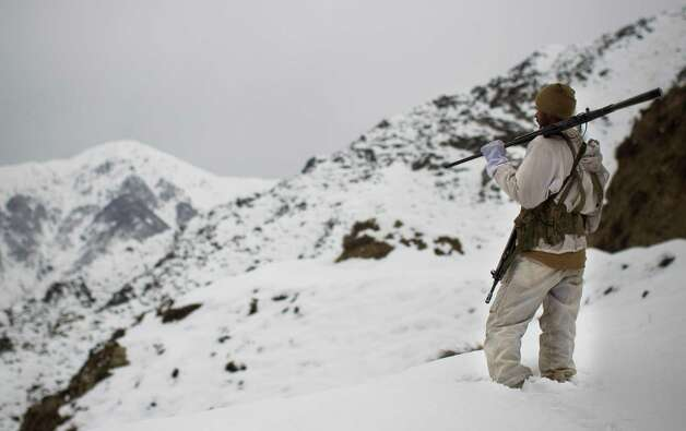 A Pakistani Army soldier with the 20th Lancers Armored Regiment patrols atop the 8000 foot mountain near their outpost at the Kalpani Base in Pakistan's Dir province on the Pakistan-Afghan border in 2012. Five years after setting up an umbrella organization to unite a violent symphony of militant groups operating in Pakistan's tribal regions, the Pakistani Taliban is fractured, strapped for cash and losing the support of a local population that is frustrated by a protracted war that has forced thousands out of their homes, say analysts and residents of the area. Photo: AP