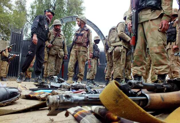 Pakistan army soldiers stand inside the police station attacked by militants in Bannu, Pakistan on Thursday. Five suicide bombers attacked a police station in the country's northwestern city of Bannu, wounding a police officer. The city's police chief Nisar Tanoli said three of the bombers detonated their explosives vests while the police shot dead the other two. Photo: AP