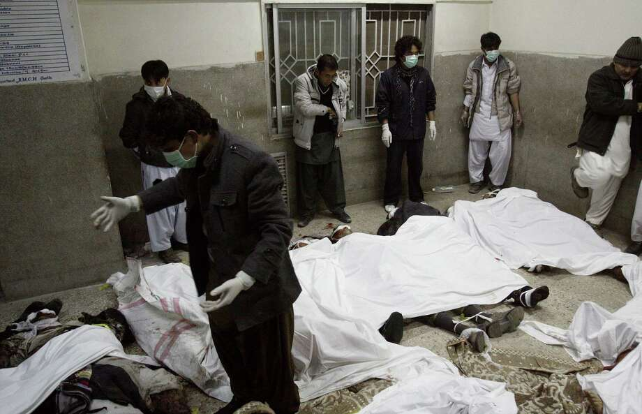 Volunteers gather next to the dead bodies of the victims of a bomb blast at the morgue of local hospital in Quetta, Pakistan on Saturday. Senior police officer Wazir Khan Nasir said the bomb went off in a Shiite Muslim-dominated residential suburb of the city of Quetta. Residents rushed the victims to three different hospitals. Photo: AP