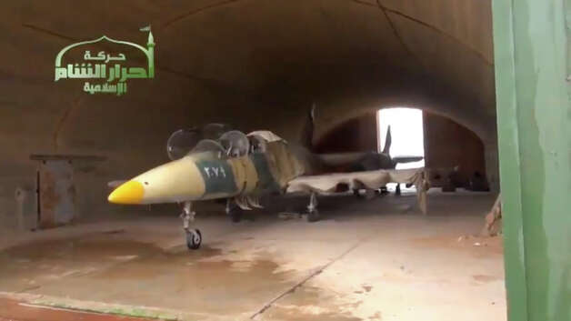 This image taken from video obtained from Ugarit News, which has been authenticated based on its contents and other AP reporting, shows a Syrian fighter jet in a hangar after rebels captured Jarrah airfield in Aleppo province, Tuesday. Rebels captured a military air base in northern Syria on Tuesday, their second major strategic victory in as many days, activists said. Photo: AP