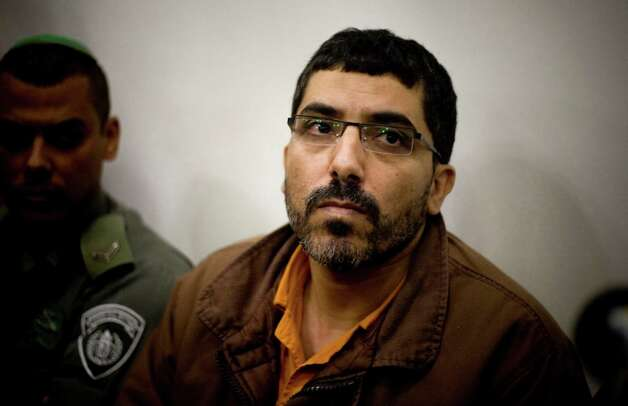 In this March 31, 2011 file photo, Palestinian engineer Dirar Abu Sisi in a court room in Petah Tikva, central Israel.  Israel's military censor, which has long served as the country's guardian of state secrets, is suddenly under the microscope following a pair of sensitive reports broken by the international media. Israeli authorities also sought to suppress knowledge of the detention of Arab engineer Dirar Abu Sisi, who vanished after boarding a train in Ukraine on Feb. 19, 2011, only to resurface in Israel three weeks later in detention. Photo: AP