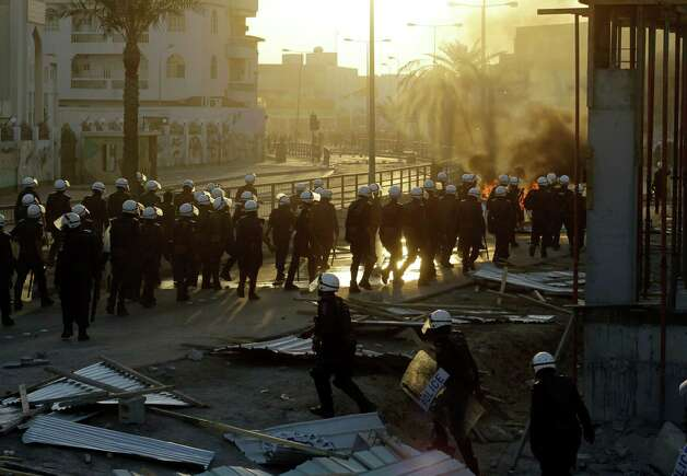 Bahraini anti-government protesters clash with riot police firing tear gas during clashes in Daih, Bahrain Saturday. Clashes erupted after the burial ceremony for a 16-year-old boy killed by police fire on Thursday's clashes when Bahraini anti-government protesters headed toward the heavily guarded site of the 2011, pro-democracy uprising. Photo: AP
