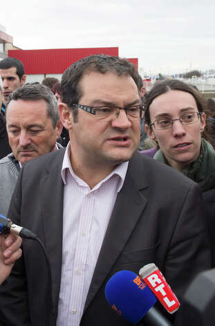 Spanghero's sales director Christophe Giry  answers reporters questions, Friday in Castelnaudary, southern France. Spanghero company is at the heart of a growing uproar over horsemeat mislabeled as beef and hidden in frozen meals.  Fraudulent meat sales reached across 13 countries and 28 companies, French officials say, primarily blaming the wholesaler in Castelnaudary. Photo: AP