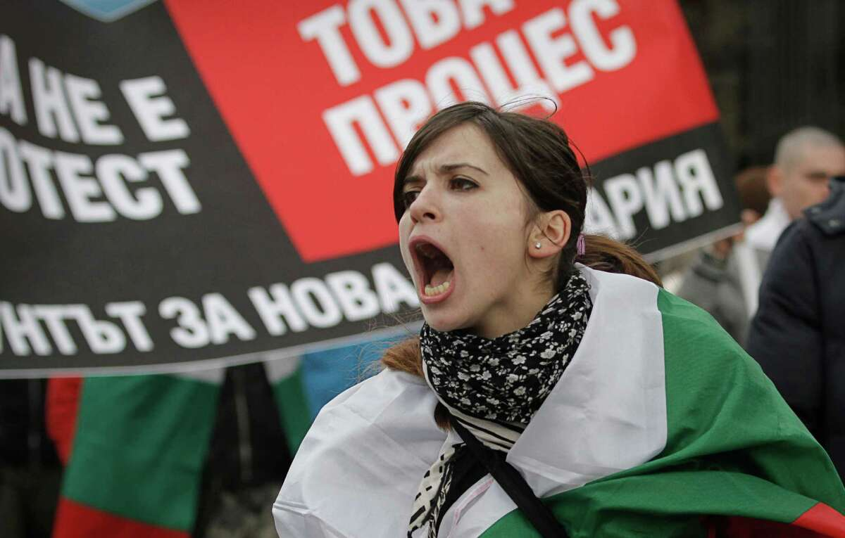 A Bulgarian woman shout slogans during a protest against higher electricity and heating bills, in Sofia, Sunday. Thousands of angry Bulgarians chanted