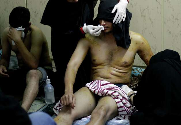 Wounded Bahraini anti-government protesters are treated at a house after shot with pellets fired by riot police during clashes in Daih, Bahrain, on Thursday, the second anniversary of the start of a pro-democracy uprising in the Gulf island kingdom. Protests began at daybreak in opposition areas nationwide as protesters attempted to return to the well-barricaded main site of the uprising. Photo: AP