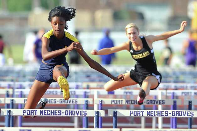 Ozen hurdler Dominique Brannon, left, takes the last hurdle for the win in the 100 meter hurdles in the District 20-4A track and field meet at Port Neches-Groves High School. Wednesday, April 13, 2011.  Valentino Mauricio/The Enterprise Photo: Valentino Mauricio / Beaumont