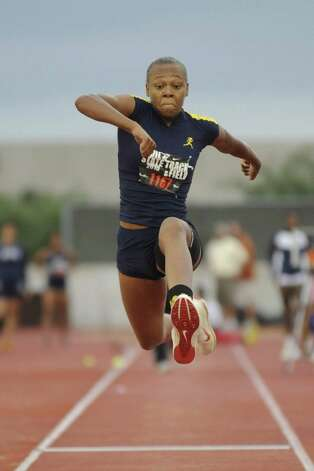 Ozen's A'Lexus Brannon leaps to a gold medal victory in the triple jump event during the UIL State Track and Field Championships at Mike A. Myers Stadium, Austin, Texas. Friday, May 14, 2010. Valentino Mauricio/The Enterprise Photo: Valentino Mauricio / Beaumont