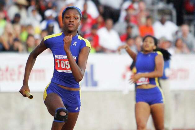 Ozen's Dominique Brannon takes the baton on the second leg of the 4A girls 800 relay. Ozen captured a third place finish in the relay at the UIL Track & Field State meet at Mike A. Myers Stadium in Austin.   May 11, 2012.  Valentino Mauricio/The Enterprise Photo: Valentino Mauricio