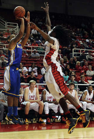 McNeese Cowboy Keelan Garrett, #3, shoots for three during the Lamar University Cardinals mens basketball game against the McNeese State Cowboys at the Montagne Center on Saturday, February 16, 2013.   Photo taken: Randy Edwards/The Enterprise