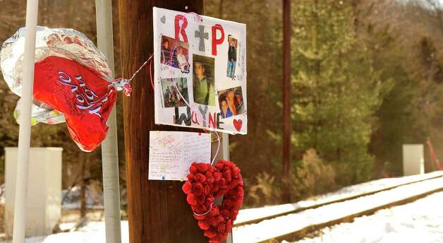 The mother of Wayne Balacky placed this memorial at the railroad crossing in Redding where her son was recently killed. Photographed Sunday, Feb. 17, 2013 in Conn. Photo: Michael Duffy / The News-Times