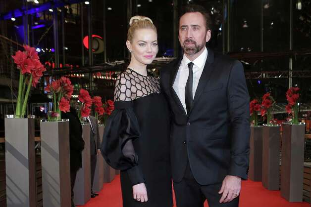 Actors Emma Stone, left, and Nicholas Cage arrive for the screening of the film The Croods at the 63rd edition of the Berlinale, International Film Festival in Berlin, Friday, Feb. 15, 2013. Photo: AP