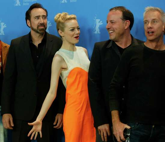 From left, actors Nicholas Cage, Emma Stone, directors Kirk De Micco and Chris Sanders pose for photographers at the photo call for the film The Croods at the 63rd edition of the Berlinale, International Film Festival in Berlin, Friday, Feb. 15, 2013. Photo: AP