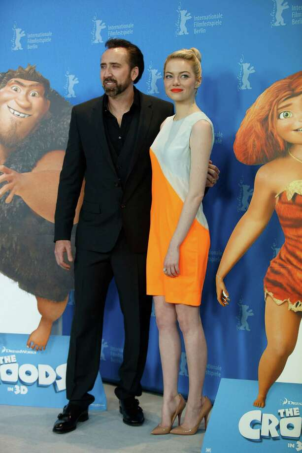 Actors Nicholas Cage and Emma Stone pose for photographers at the photo call for the film The Croods at the 63rd edition of the Berlinale, International Film Festival in Berlin, Friday, Feb. 15, 2013. Photo: AP