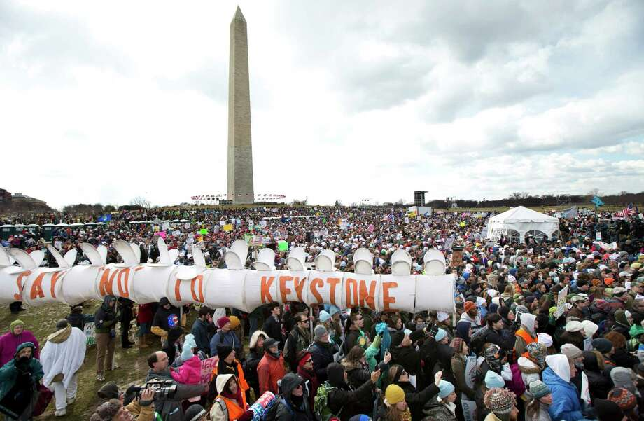 "Thousands of protestors gather at the National Mall in Washington calling on President Barack Obama to reject the Keystone XL oil pipeline from Canada, as well as act to limit carbon pollution from power plants and ""move beyond"" coal and natural gas, Sunday, Feb. 17, 2013.   (AP Photo/Manuel Balce Ceneta) Photo: Manuel Balce Ceneta, Associated Press / AP"