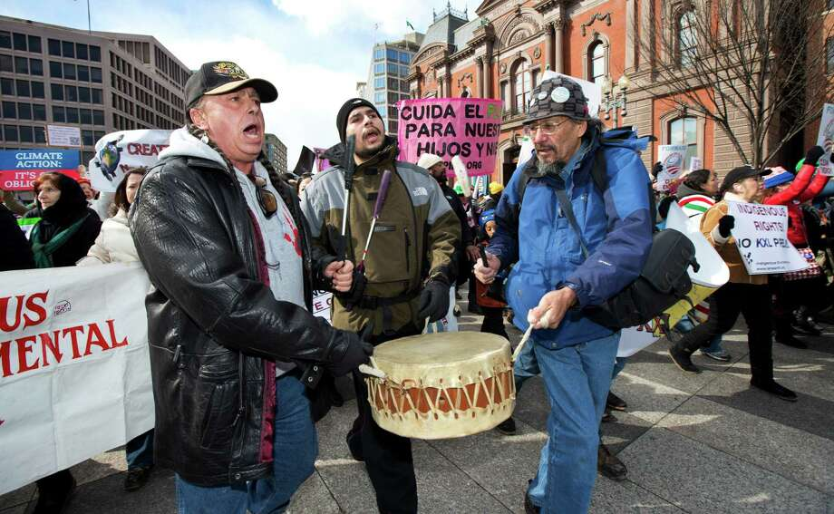 "Chief Tayac of the Piscataway tribe, from left, Naiche Tayac, and William of the Lakota Nation play a drum as they march near the White House in Washington during a rally calling on President Barack Obama to reject the Keystone XL oil pipeline from Canada, as well as act to limit carbon pollution from power plants and ""move beyond"" coal and natural gas, Sunday, Feb. 17, 2013.   (AP Photo/Manuel Balce Ceneta) Photo: Manuel Balce Ceneta, Associated Press / AP"