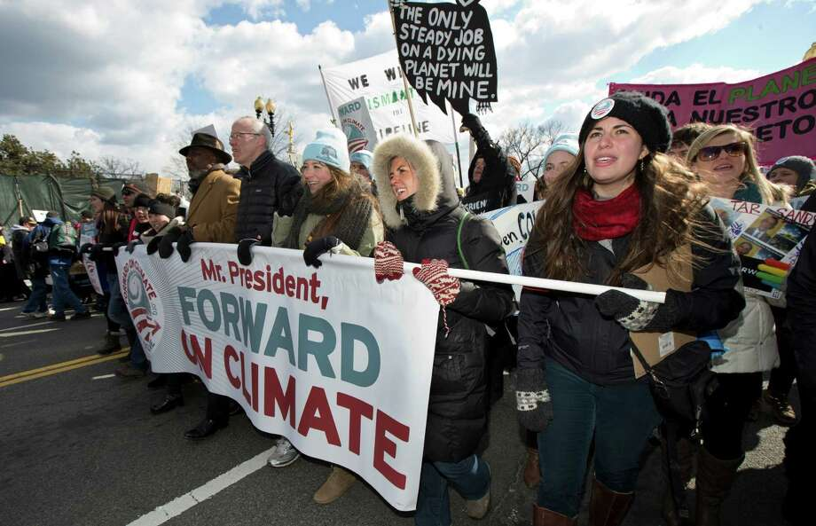 "From center to right; Bill McKibben, Fiona McRaith, Leah Qusba and Maayan Cohen join a march from the National Mall to the White House in Washington during a rally on calling on President Barack Obama to reject the Keystone XL oil pipeline from Canada, as well as act to limit carbon pollution from power plants and ""move beyond"" coal and natural gas, Sunday, Feb. 17, 2013.   (AP Photo/Manuel Balce Ceneta) Photo: Manuel Balce Ceneta, Associated Press / AP"