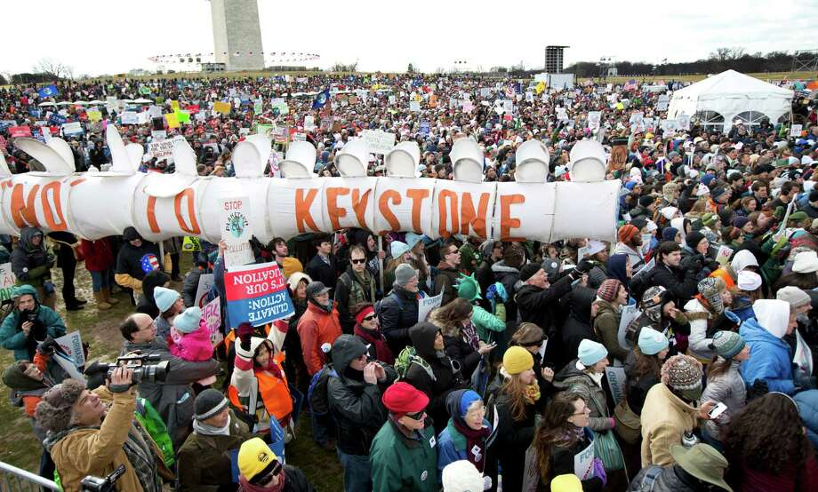 """Protestors gather at the National Mall in Washington calling on President Barack Obama to reject the Keystone XL oil pipeline from Canada, as well as act to limit carbon pollution from power plants and """"move beyond"""" coal and natural gas, Sunday, Feb. 17, 2013.   (AP Photo/Manuel Balce Ceneta) Photo: Manuel Balce Ceneta, Associated Press / AP"""