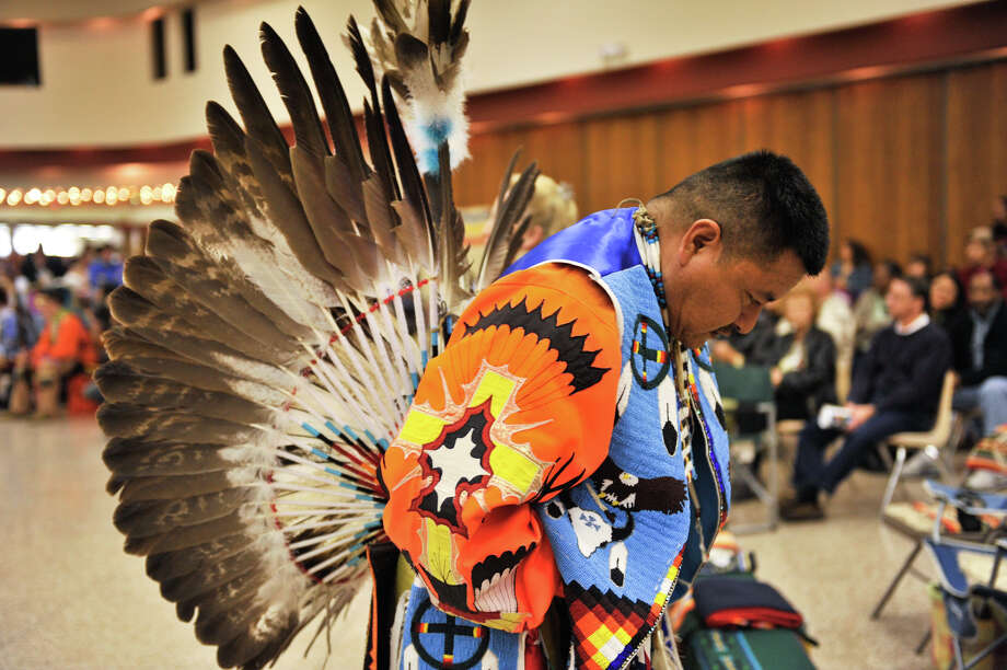 Ryan Sandoval pauses before the Grand Entry during the 16th Annual United San Antonio Pow Wow at the Alzafar Shrine Auditorium Sunday.