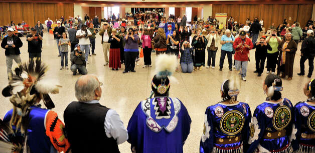 Attendee's of the 16th Annual United San Antonio Pow Wow gather for a photo op during Sunday ceremonies at the Alzafar Shrine Auditorium. Native American Tribes from around the nation participated.