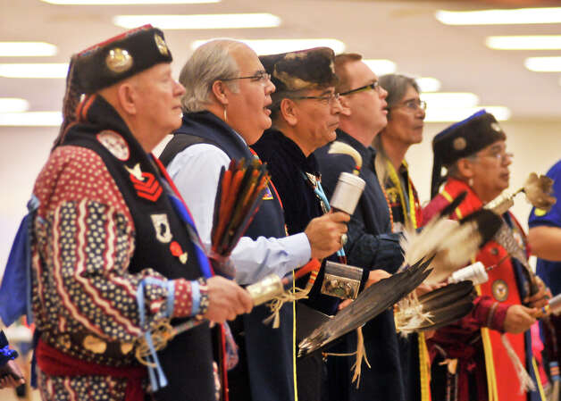Attendee's of the 16th Annual United San Antonio Pow Wow sing during Sunday ceremonies at the Alzafar Shrine Auditorium. Native American Tribes from around the nation participated.