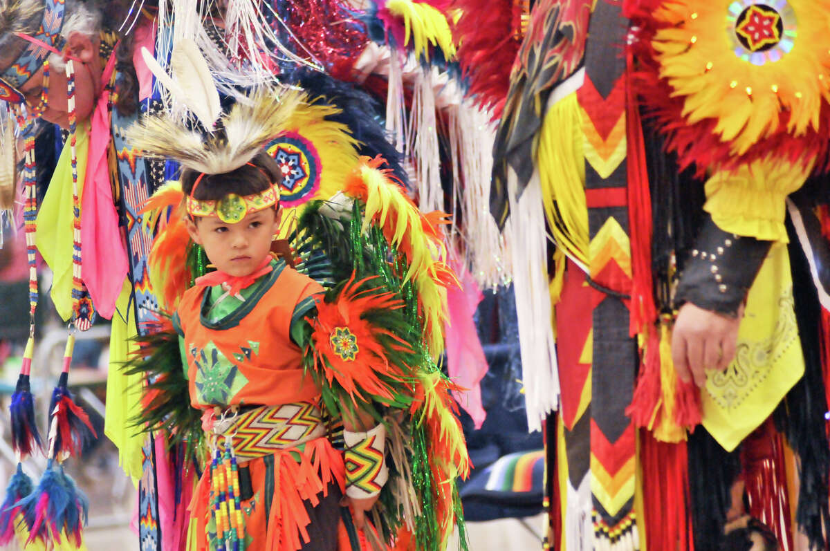 Robby James Soto, 6, watches Native American dancers perform during the 16th Annual United San Antonio Pow Wow at the Alzafar Shrine Auditorium Sunday afternoon.
