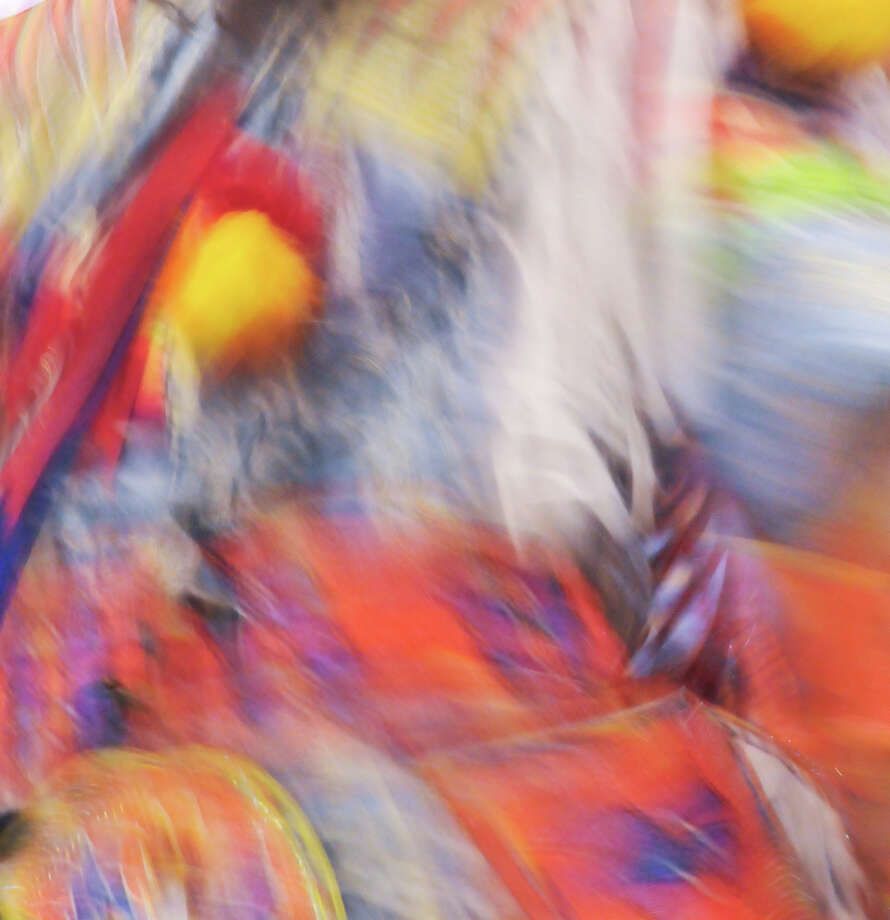 A dancer's costume is a blur of color during the 16th Annual United San Antonio Pow Wow Sunday at the Alzafar Shrine Auditorium.