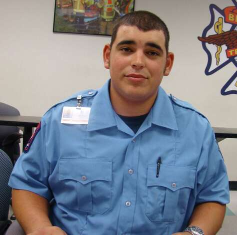 This photo provided by the City of Bryan shows firefighter Mitchel Moran, in serious but stable condition, Sunday, Feb. 17, 2013, as investigators try to determine what sparked a lodge hall fire that killed two colleagues. (AP Photo/City of Bryan) Photo: HOPD / City of Bryan